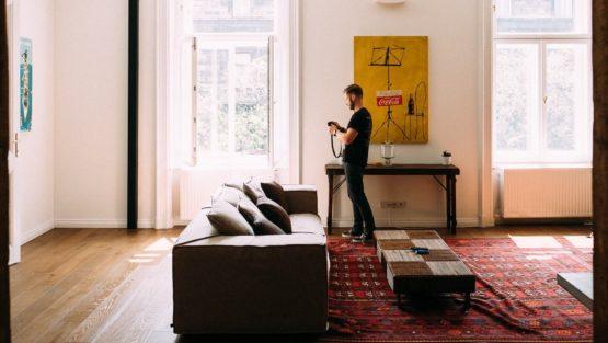 man in living room end of tenancy clean